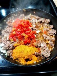 cooking oven baked beef taco supreme in a black pan