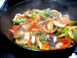 Peppers and onions cooking for Better Than Philly Cheesesteaks
