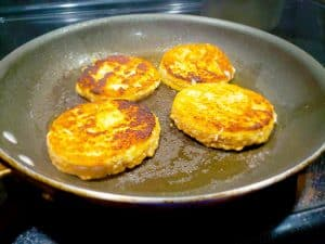 Greek Salmon Burgers Cooking in a Pan