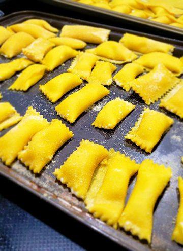 Homemade Agnolotti frozen on a pan