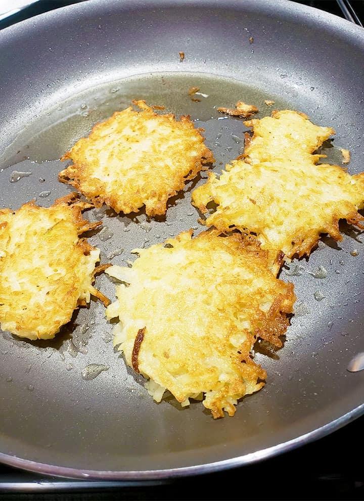 Potato Pancakes Latkes Cooking in a frying pan