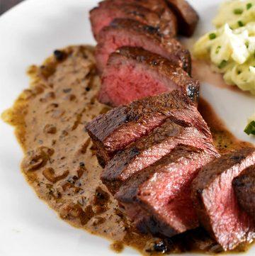 Sous Vide Steak recipe over whiskey pan sauce