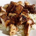 Copycat Chipotle Chicken Recipe chopped and sitting on rice on a white plate