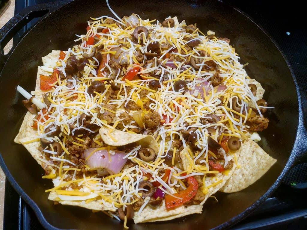 Loaded Nachos in a cast iron pan