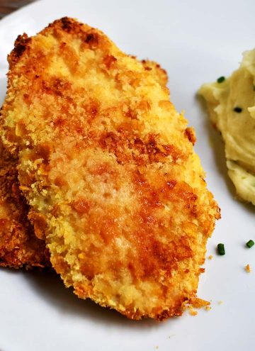 Parmesan Crusted Chicken on a white plate