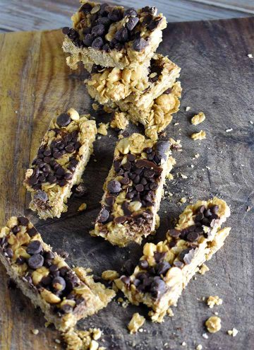 homemade granola bars on a wooden cutting board