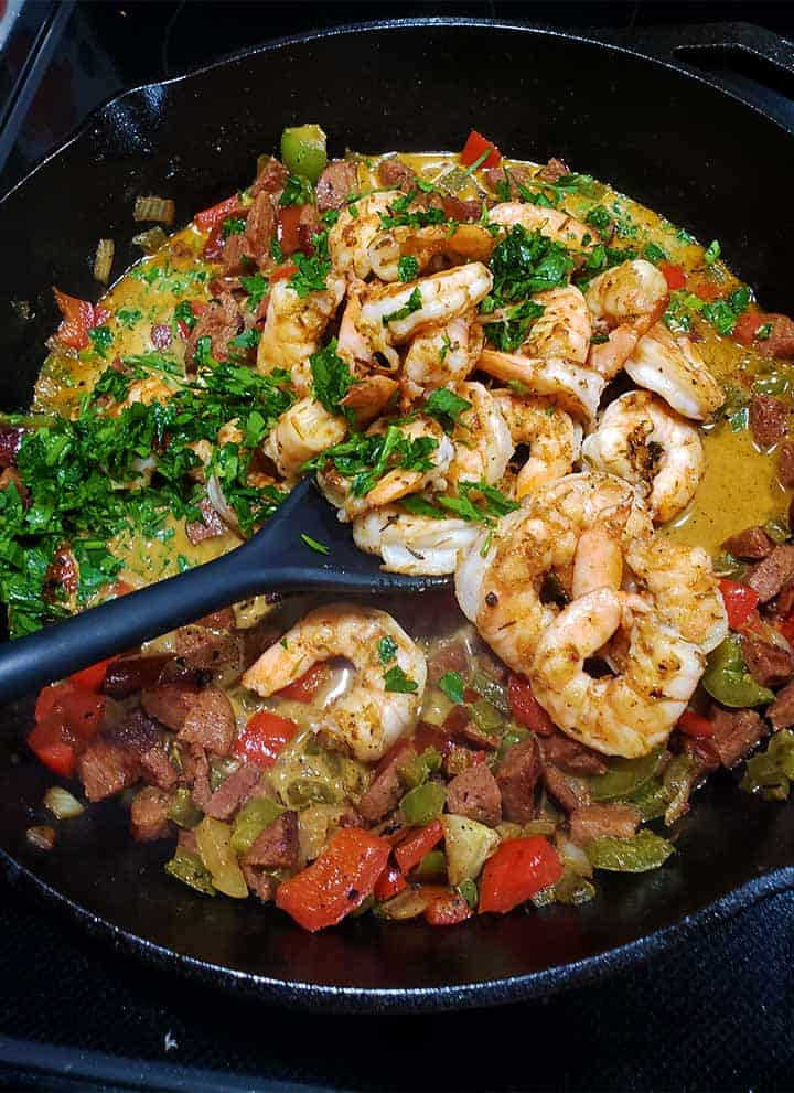 shrimp and grits toppings in cast iron pan