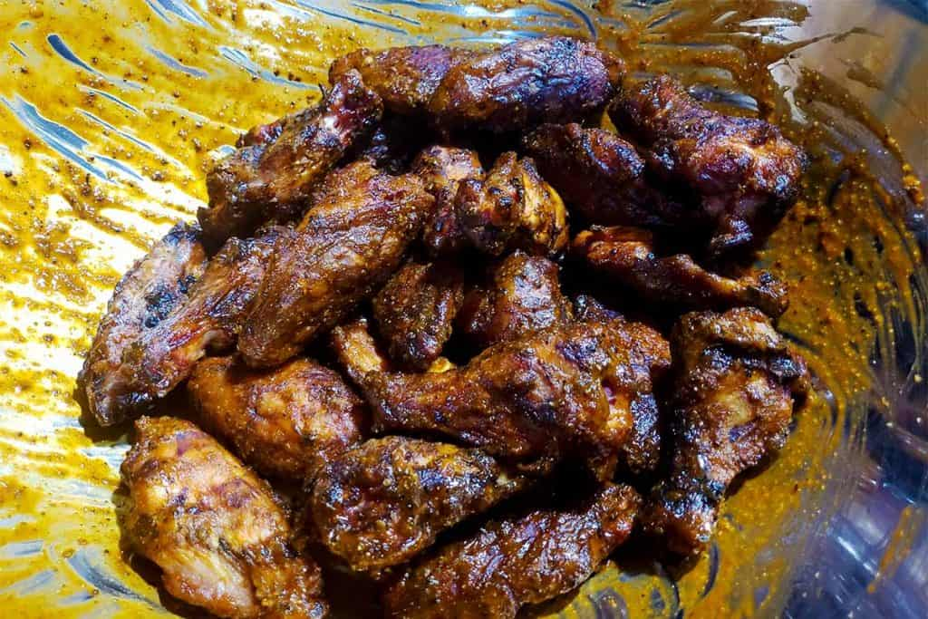 smoked chicken wings tossed with buffalo sauce
