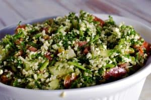 cauliflower tabbouleh in a white serving bowl