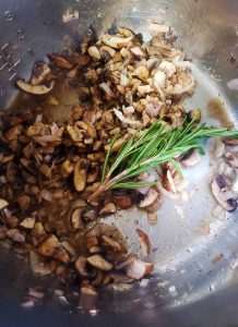 mushrooms and rosemary cooking in an instant pot