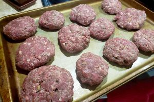 raw lamb kibbeh on baking sheet