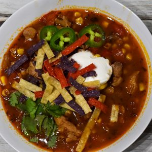 instant pot chicken tortilla soup with sour cream, cilantro, tortilla strips and jalapeno