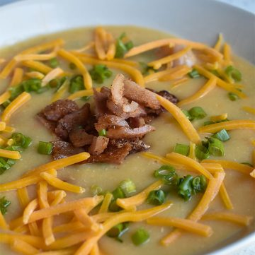 instant pot loaded baked potato soup in a white bowl
