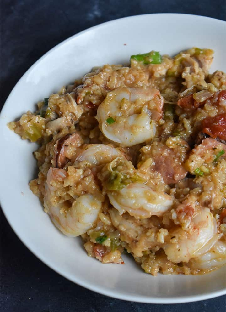 Instant Pot Jambalaya in a white bowl on a black table