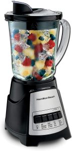 countertop blender filled with fruit and ice